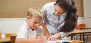 teacher helping young student