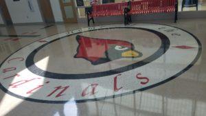 Home of the Cardinals logo on floor of school