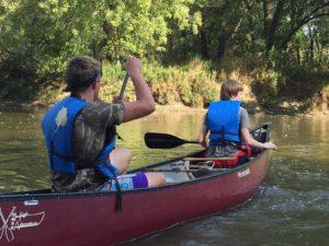 students canoeing
