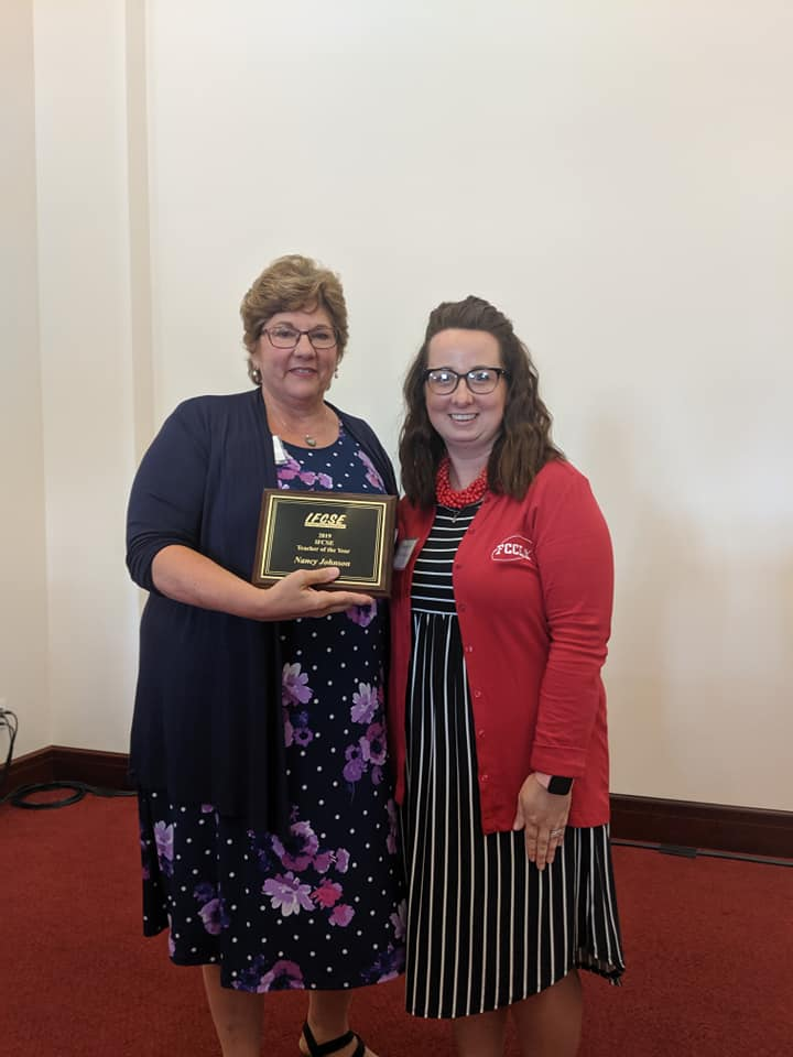 Mrs. Nancy Johnson (left) accepts her Educator of the Year Award from IFCSE President Courtney Roll. Roll is also the IFCSE Representative for the Iowa American Career and Technical Association (ACTE) and FCS teacher at Iowa Falls-Alden High School.