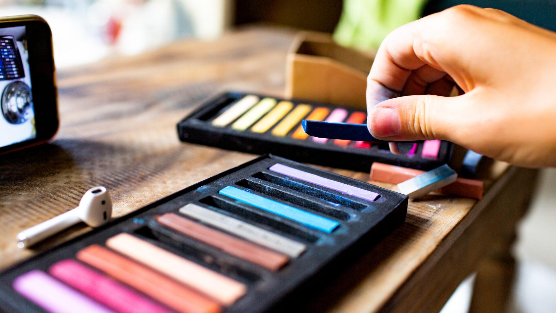 hand using pastels